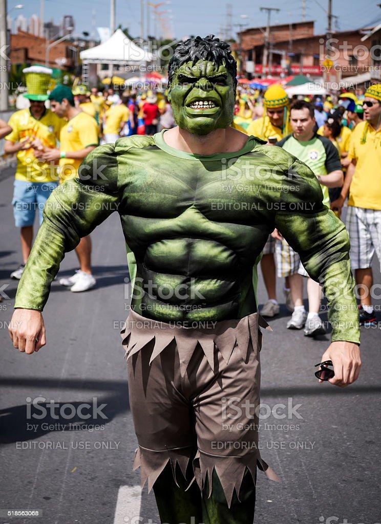 Brazilian football fan dressed as The Hulk stock photo