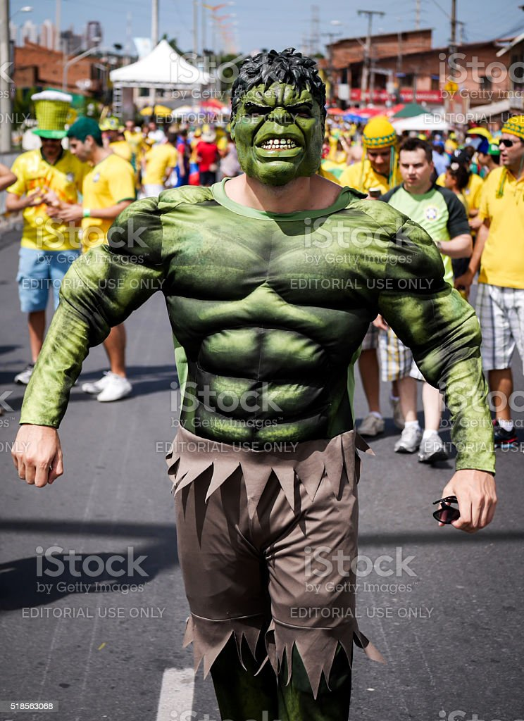 Brazilian football fan dressed as The Hulk stock photo