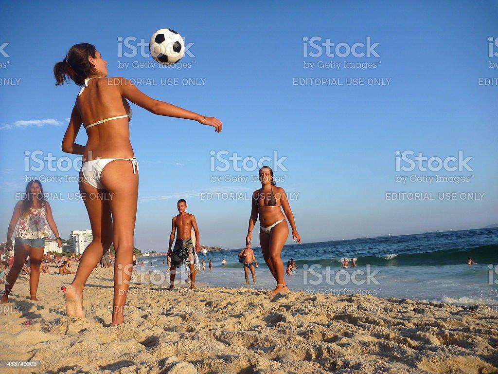 Brazilian Friends Playing Football Soccer Ipanema Beach Rio de Janeiro stock photo