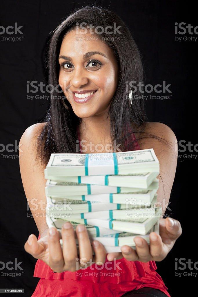 Brazilian girl isolated on black with dollar bills royalty-free stock photo