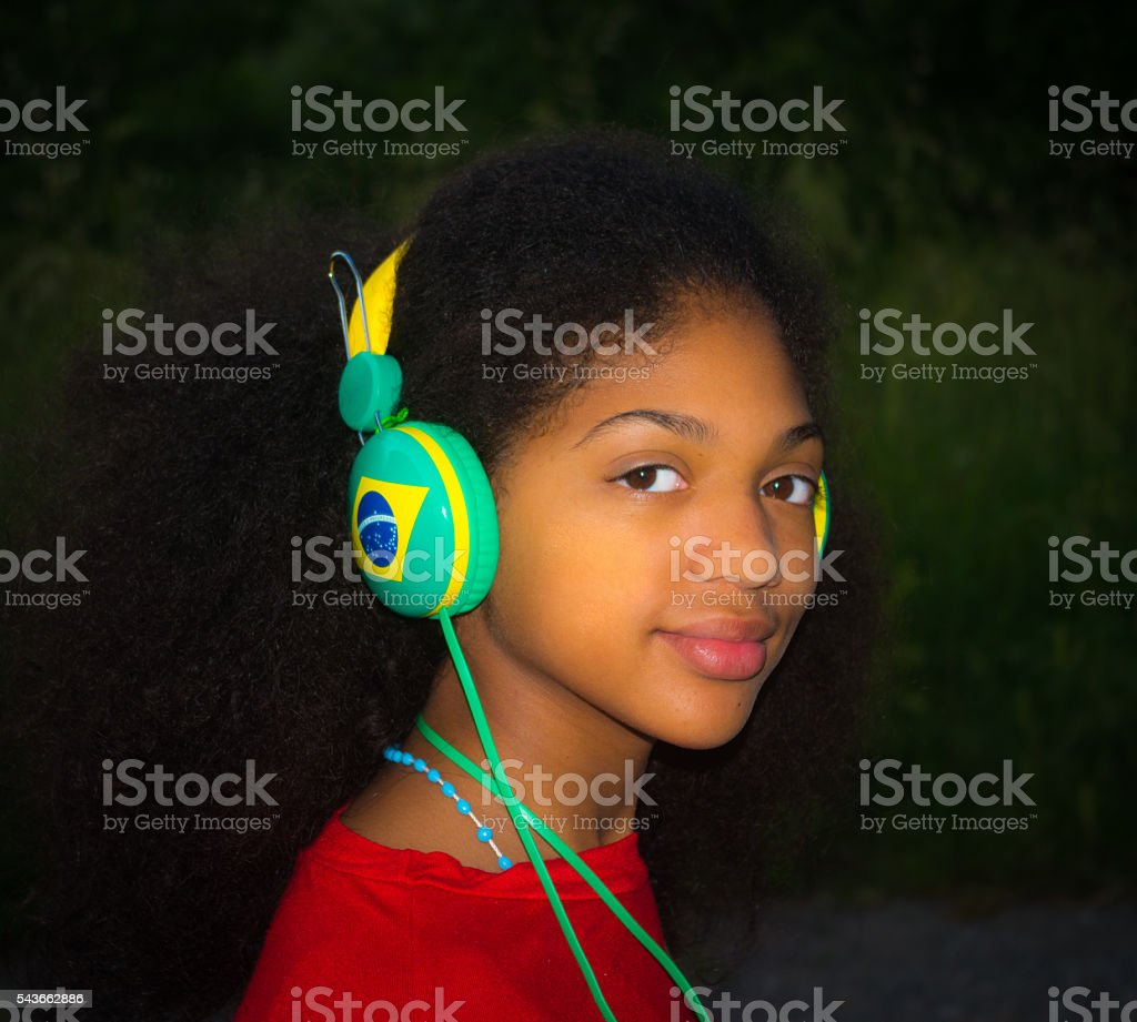 Brazilian girl scolta music while waiting for the Olympic Games stock photo