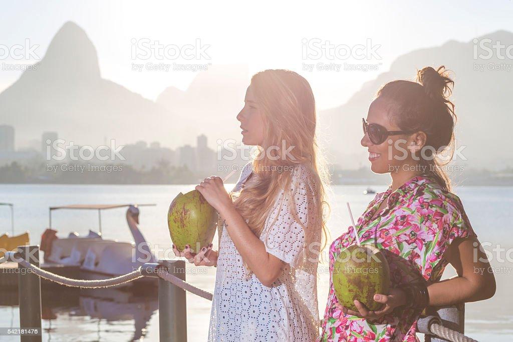Brazilian girls drinking coconut water stock photo
