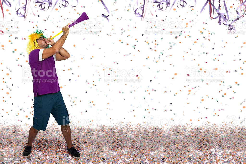 Brazilian guy blowing a horn at Carnival stock photo