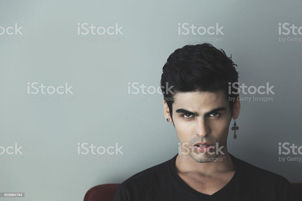 Brazilian guy with evil look stock photo