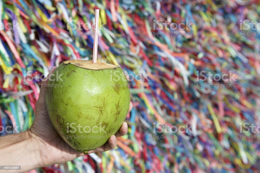 Brazilian Hand Holding Coco Gelado Wish Ribbons Salvador Bahia stock photo