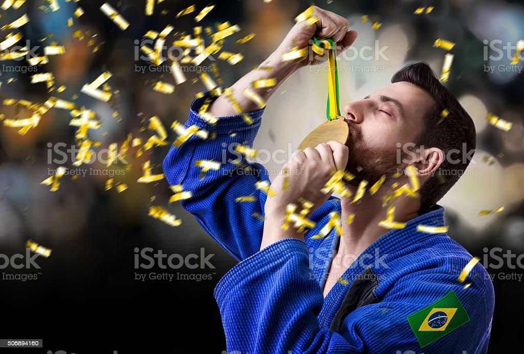 Brazilian judoka fighter man in the stadium stock photo