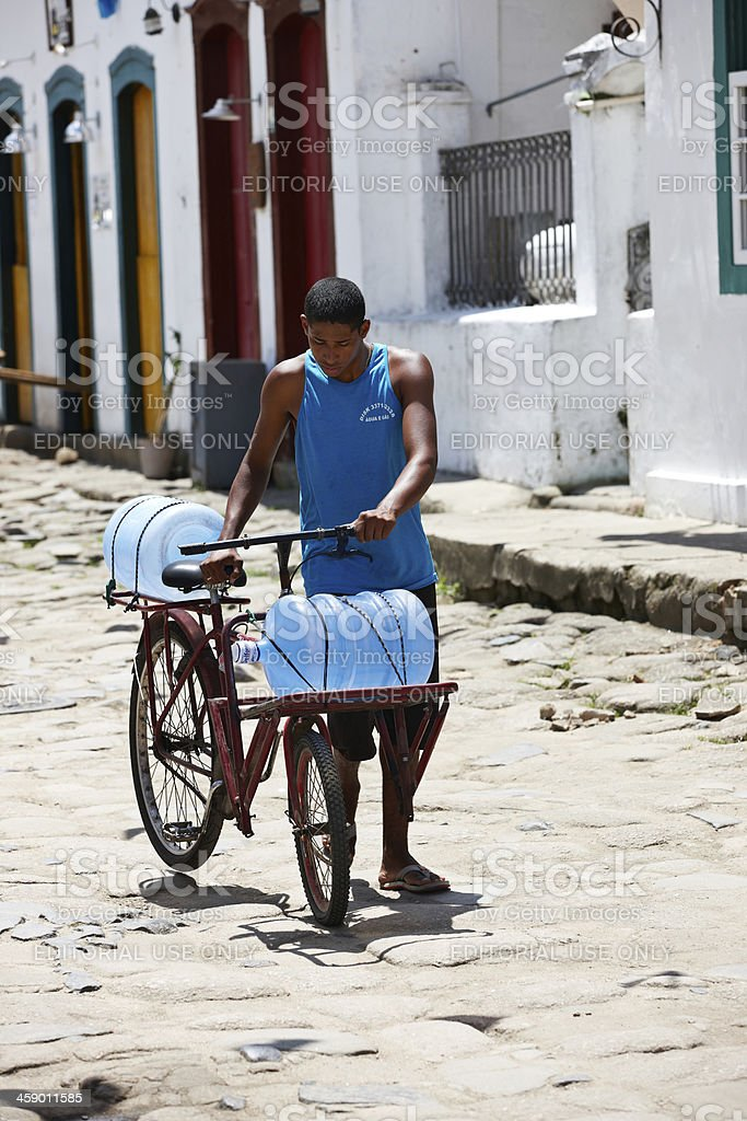 Brazilian man delivering water on bicycle royalty-free stock photo