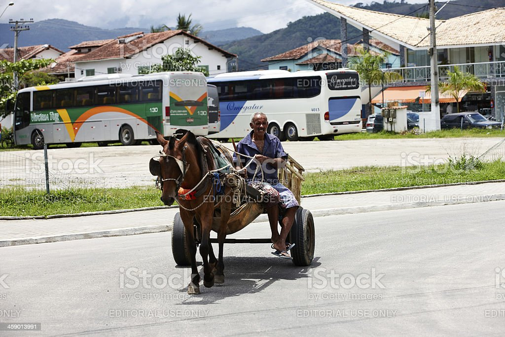 Brazilian man driving horse and cart royalty-free stock photo