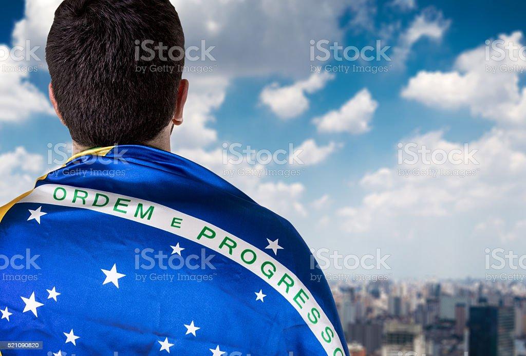 Brazilian man holding the flag in Sao Paulo stock photo