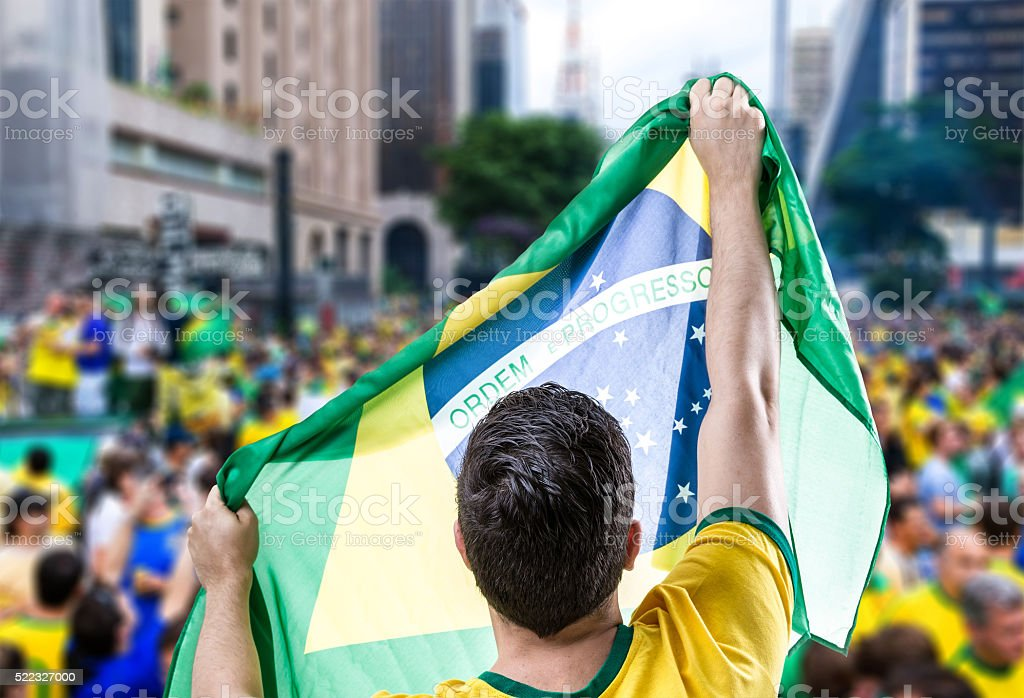 Brazilian man holding the flag in Sao Paulo stock photo