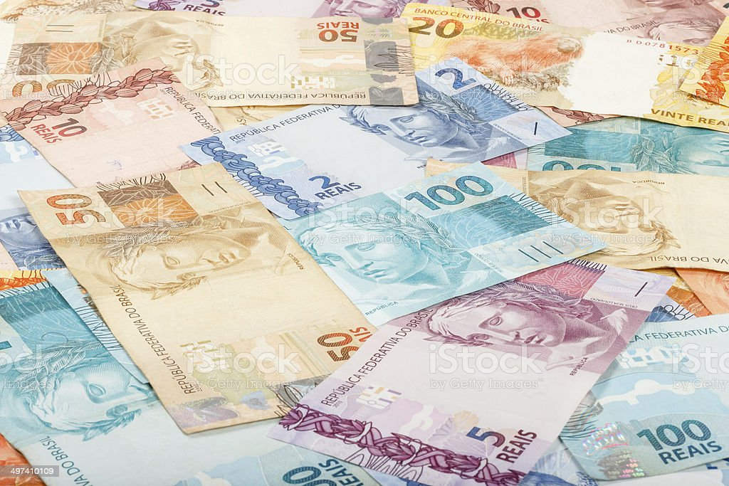 Brazilian money. A lot of new real notes. stock photo