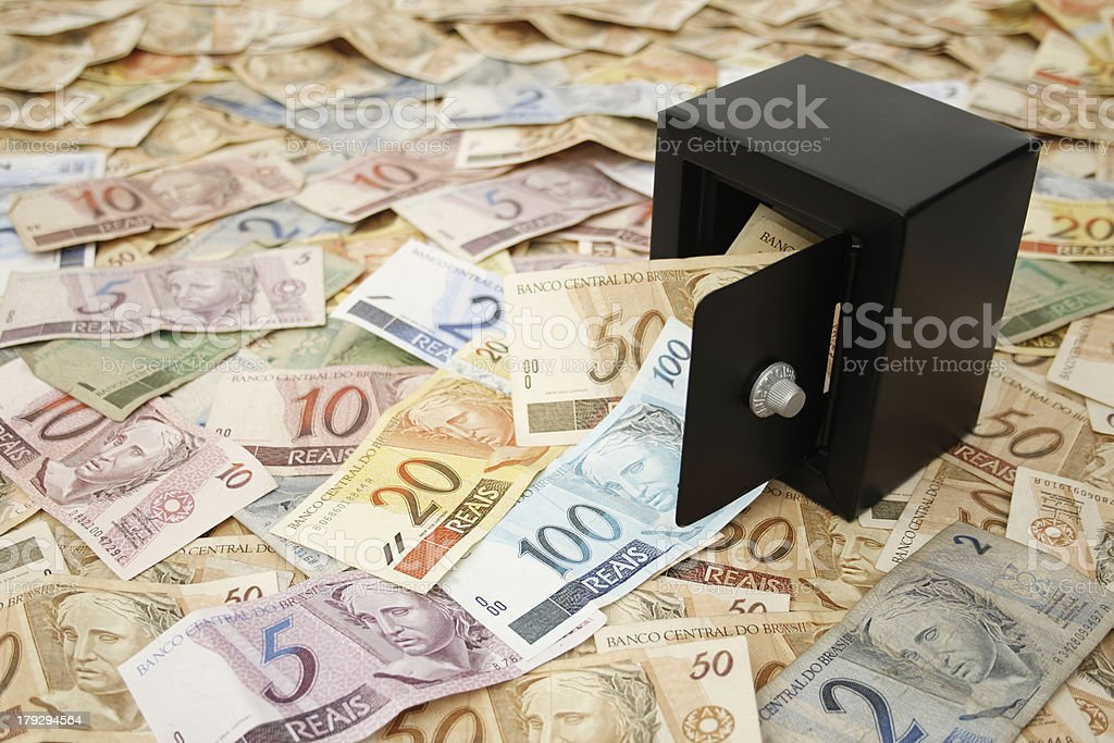 Brazilian money and a black safe stock photo