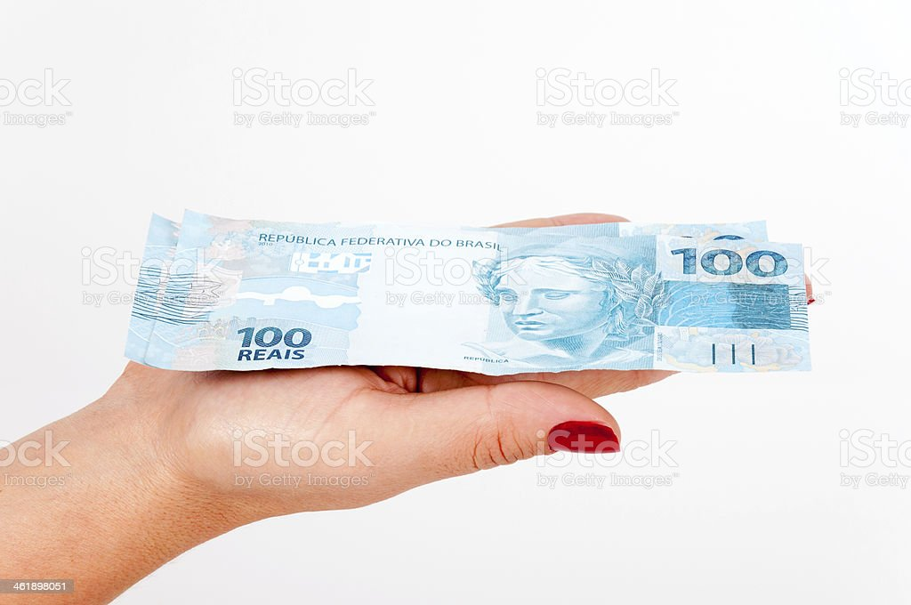 Brazilian money in the hands stock photo