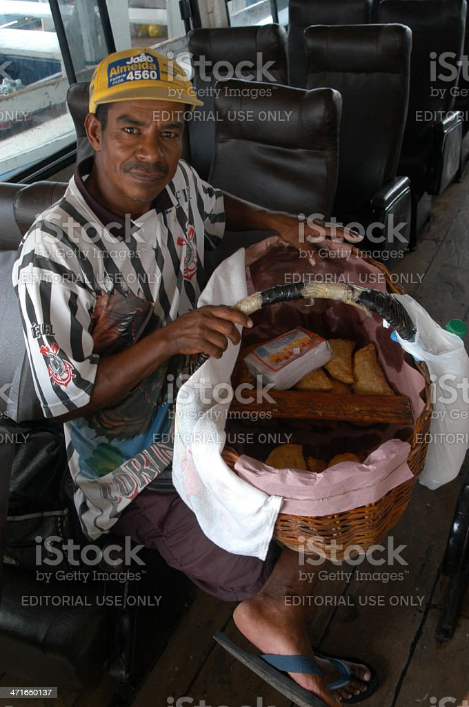 Brazilian Pastel Vendor Sells Pastries in a Basket on Ferry stock photo
