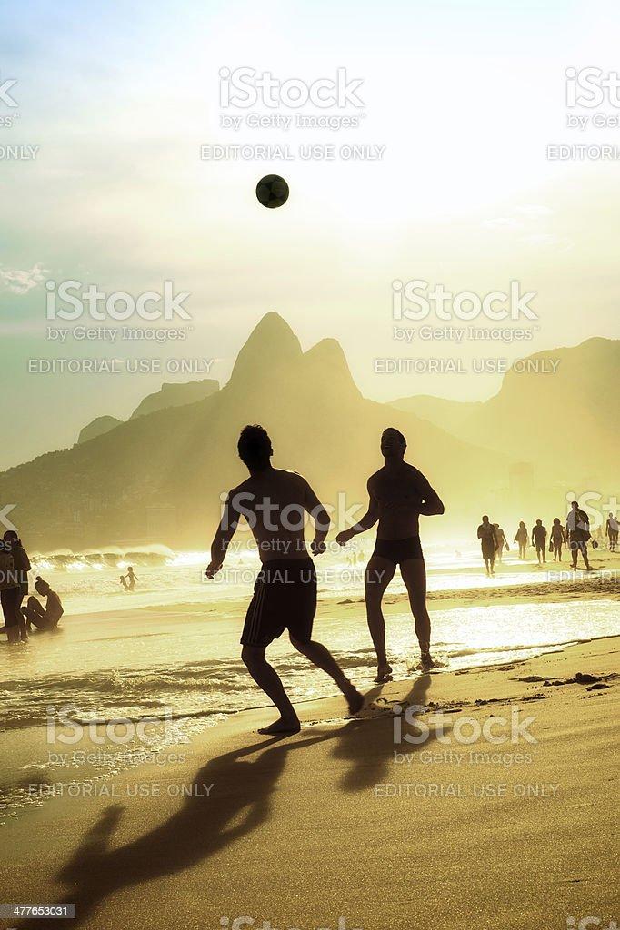 Brazilian People Playing Football Soccer Ipanema Beach Rio Janeiro Brazil stock photo