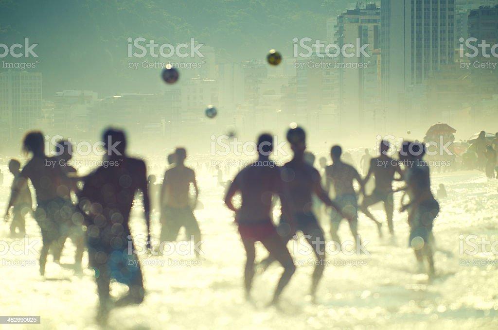 Brazilian People Playing Football Soccer Rio de Janeiro Beach stock photo