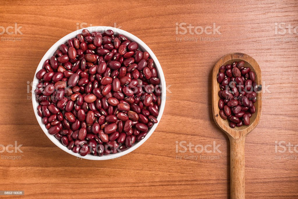 Brazilian Red Beans into a bowl and spoon. Phaseolus vulgaris stock photo