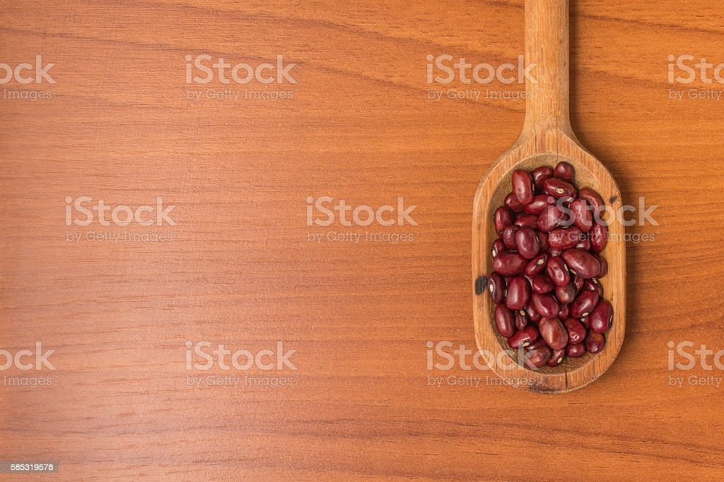 Brazilian Red Beans into a spoon. Phaseolus vulgaris stock photo
