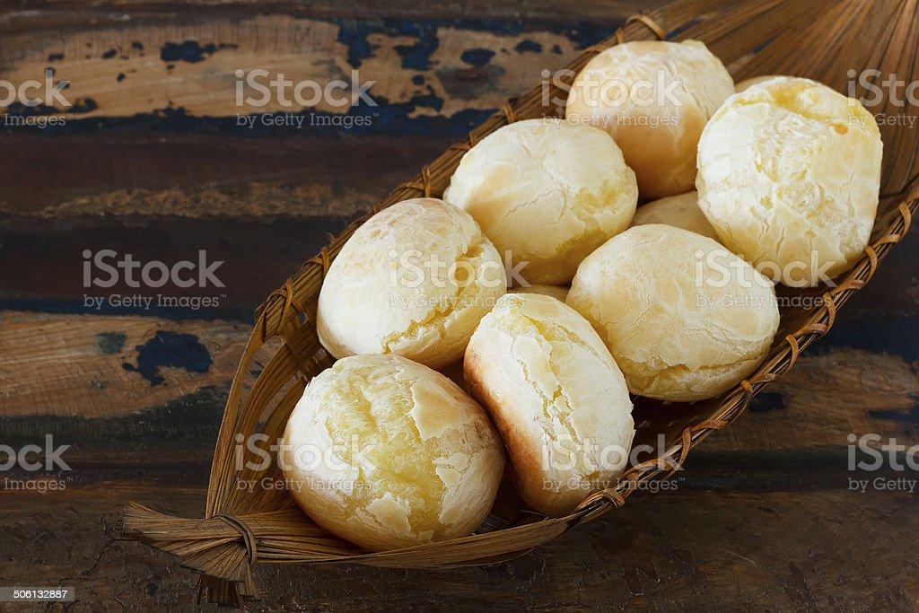 Brazilian snack pao de queijo  (cheese bread) in wicker basket stock photo