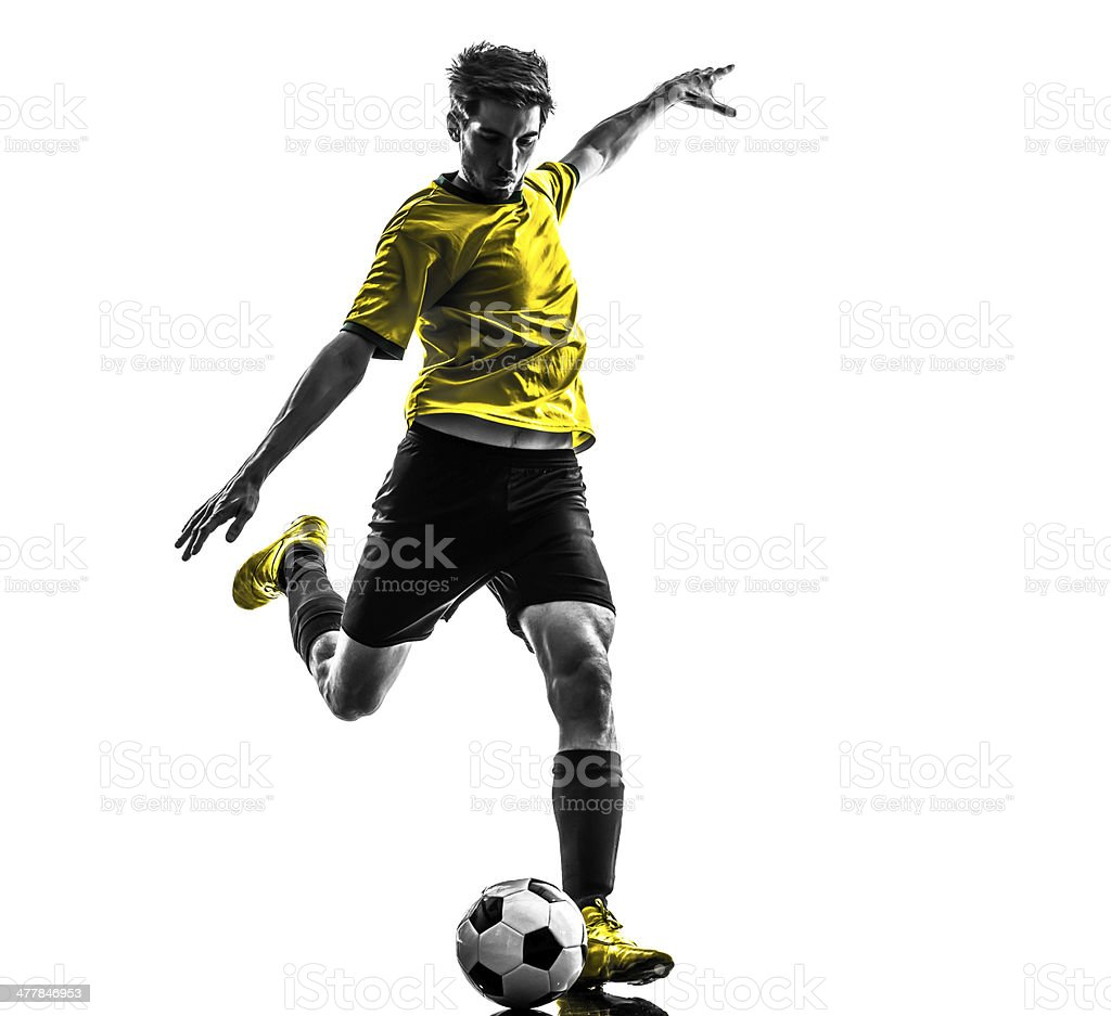 brazilian soccer football player young man kicking silhouette stock photo
