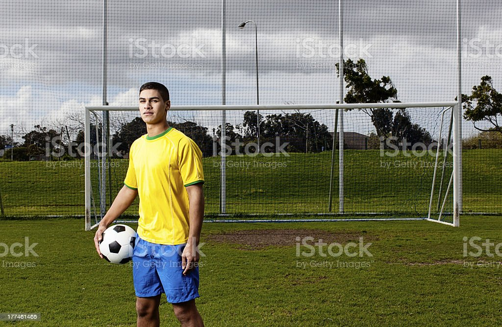 Brazilian soccer player in front of goal post royalty-free stock photo
