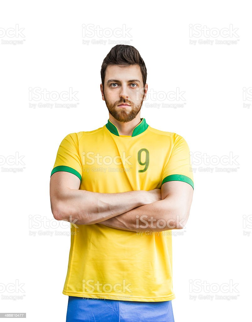 Brazilian soccer player looks serious on white background stock photo