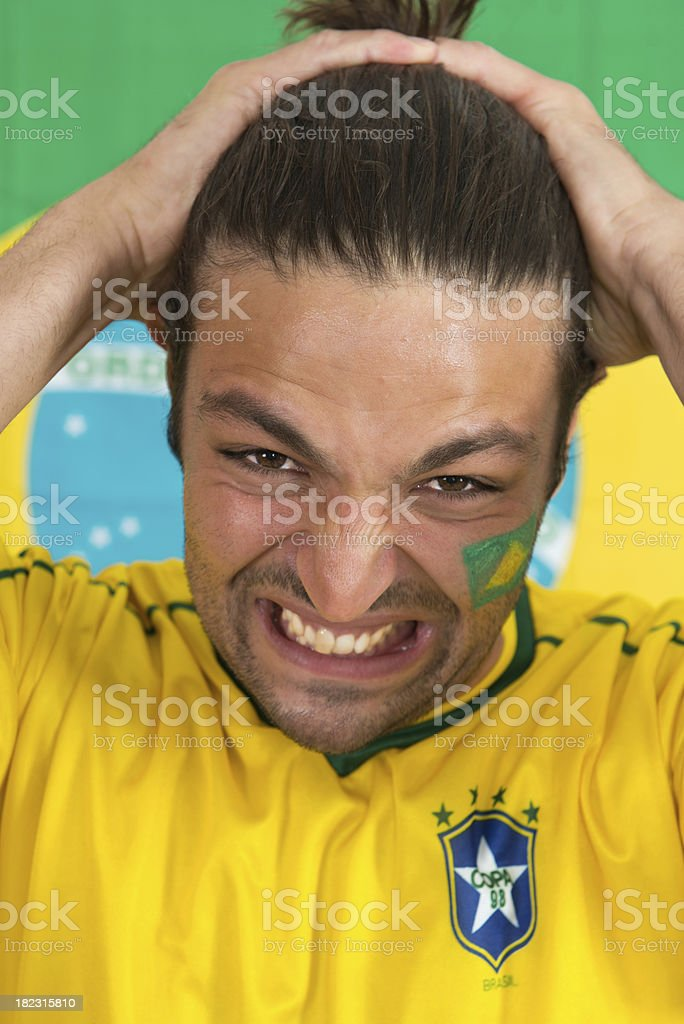 Brazilian sports fan in dispair royalty-free stock photo