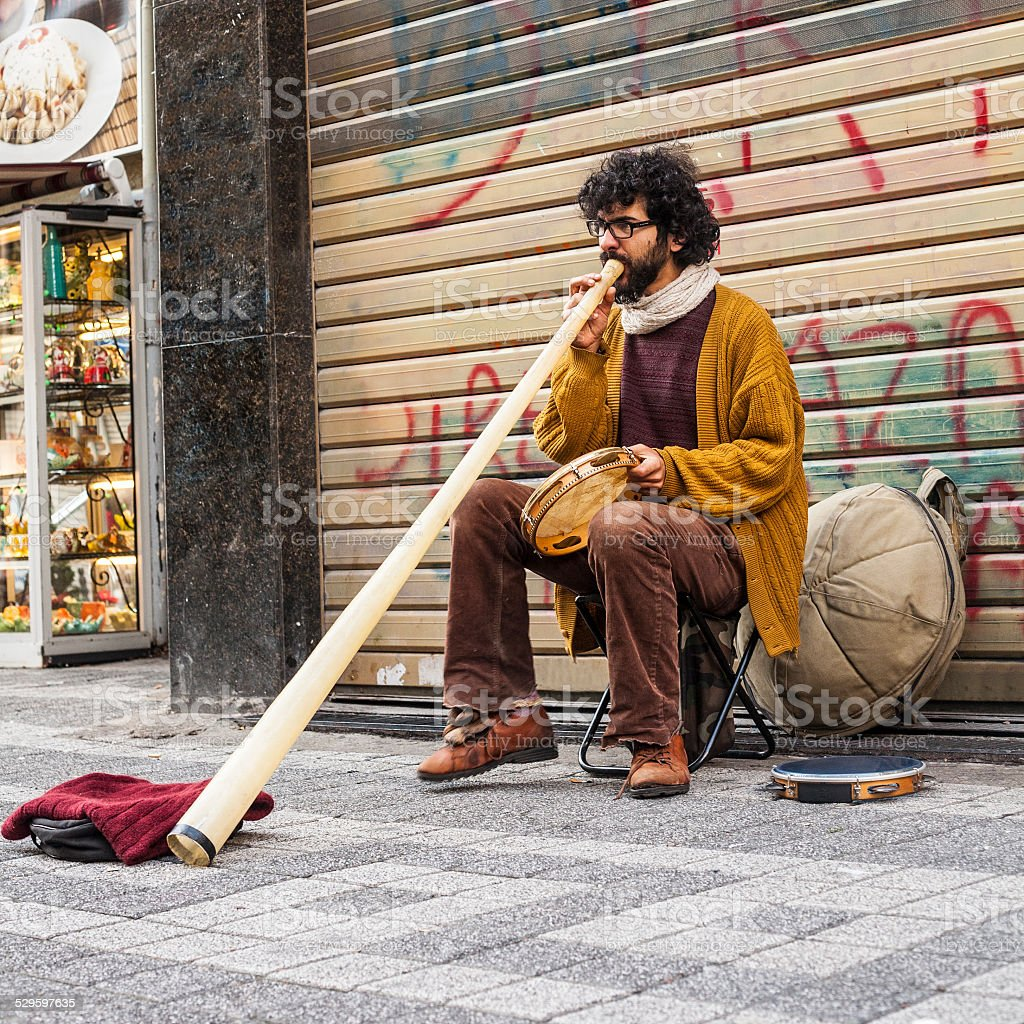 Brazilian street musician in turkey plays caribbean drum and didgeridoo stock photo