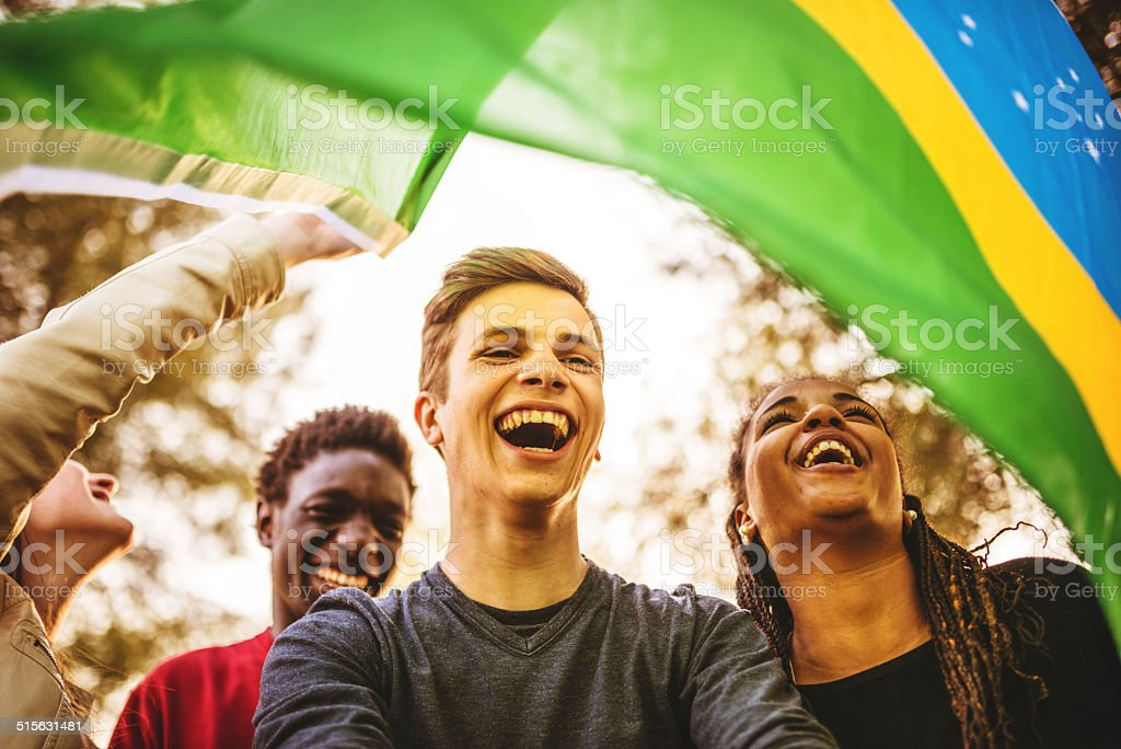 Brazilian supporter enjoying togetherness stock photo