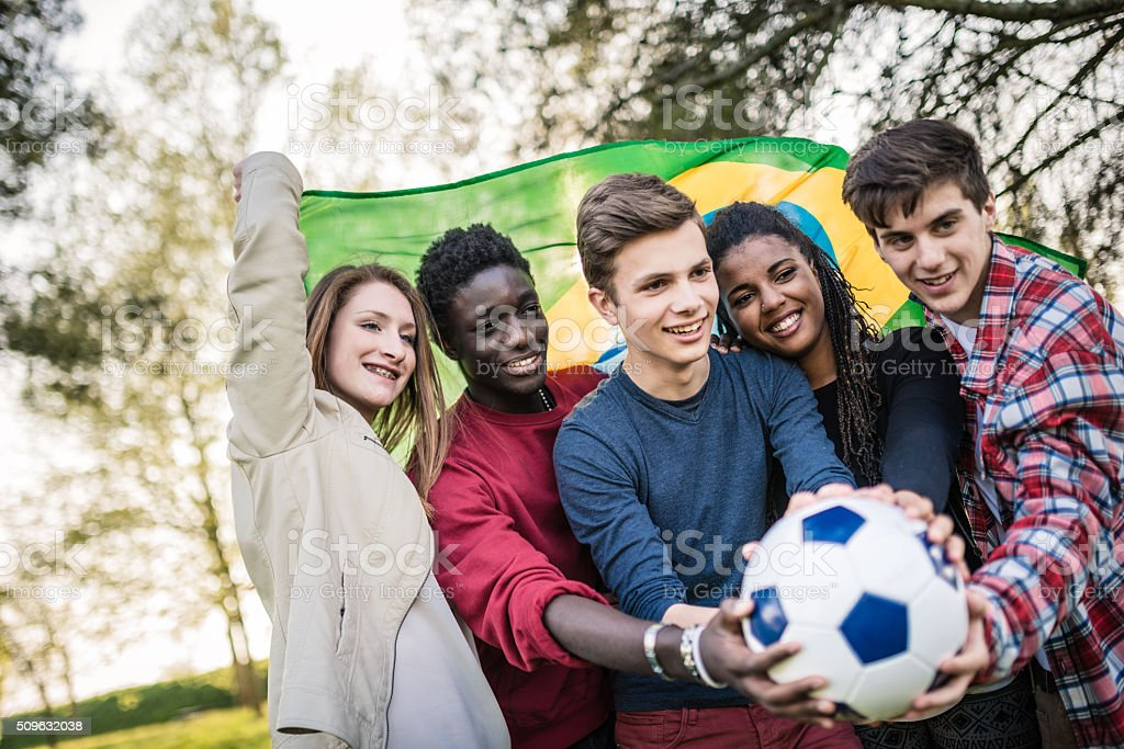 Brazilian supporter with soccer ball stock photo