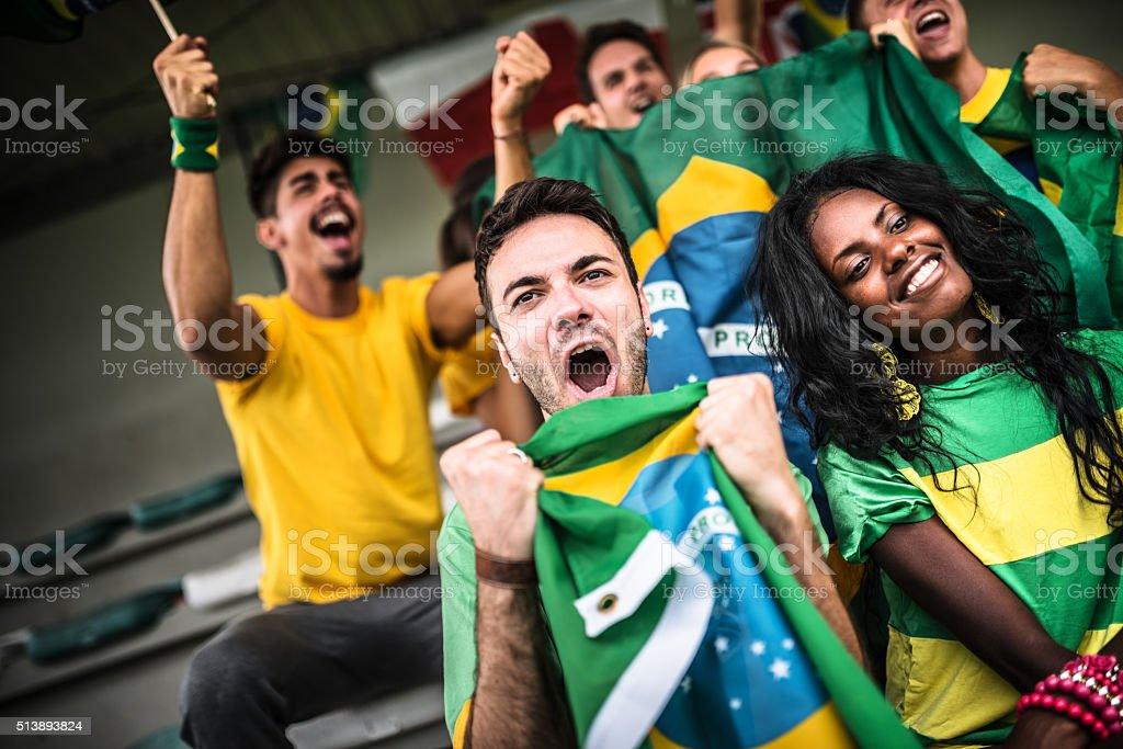 Brazilian supporters cheering at stadium stock photo