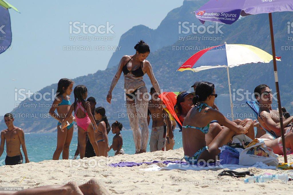 Brazilian Woman Applying Hair Removal Cream on Ipanema Beach royalty-free stock photo