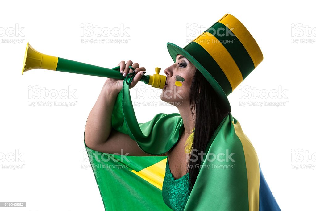 Brazilian woman fan blowing by vuvuzela on white background stock photo
