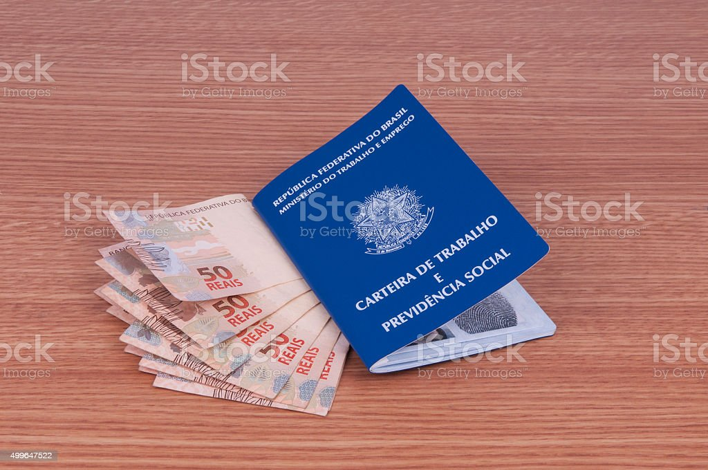 Brazilian work document and social security document (carteira de trabalho) and currency stock photo