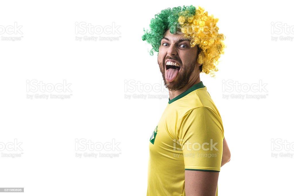 Brazilian young fan celebrating on white background stock photo