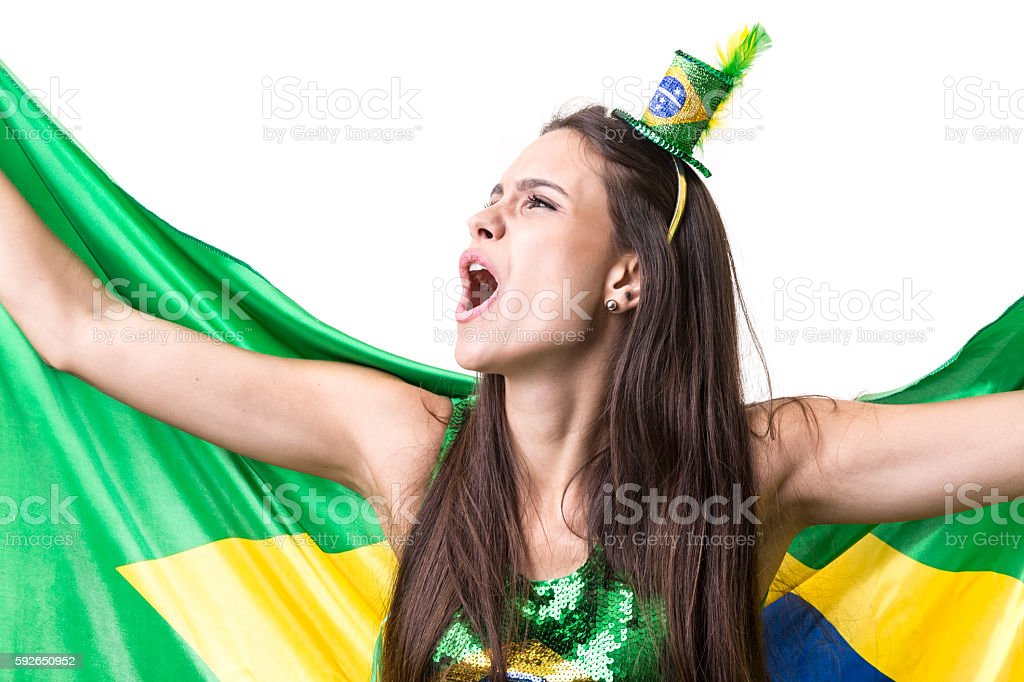 Brazilian young fan holding the flag of Brazil stock photo