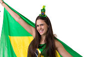 Brazilian young fan holding the flag of Brazil