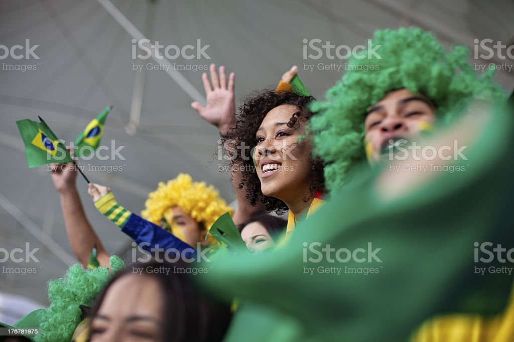 Brazilians cheering for their football team. royalty-free stock photo