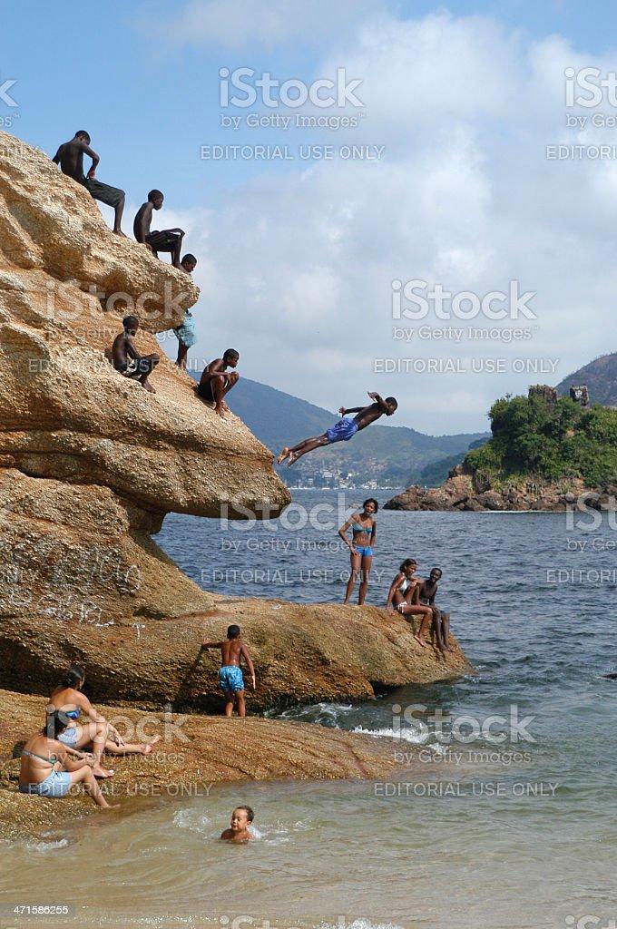Brazilians Dive from Rock Cliffs into Sea Near Rio royalty-free stock photo