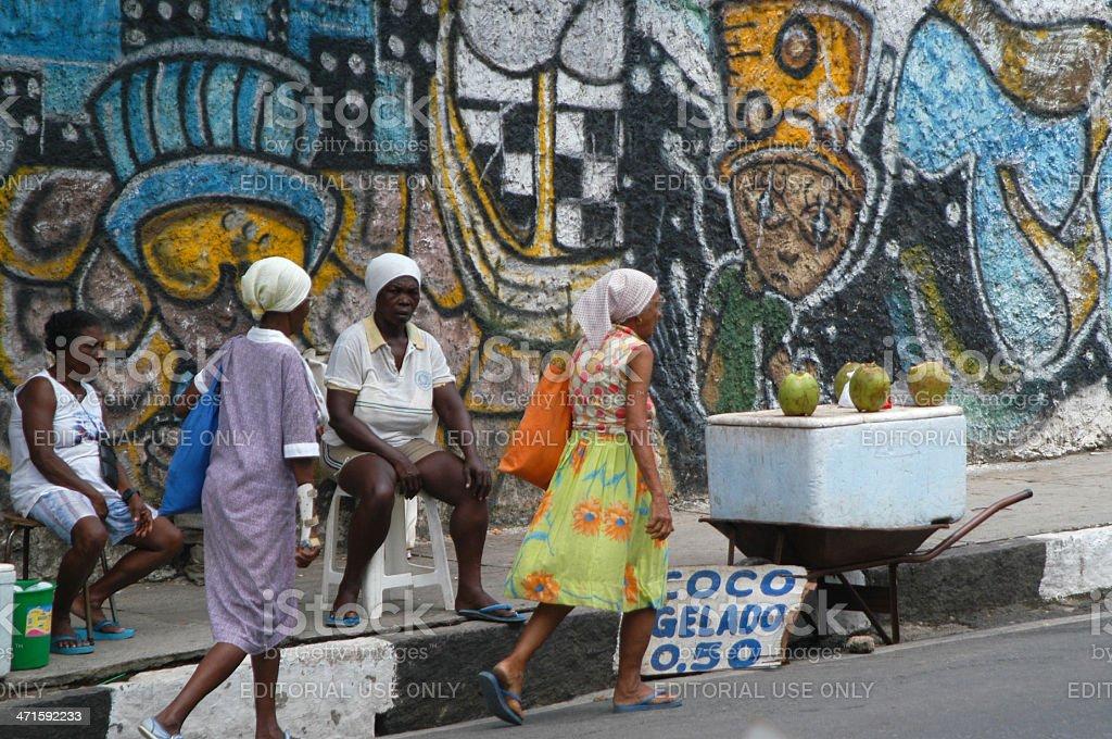 Brazilians Pass Coco Gelado Stand in Salvador Brazil stock photo