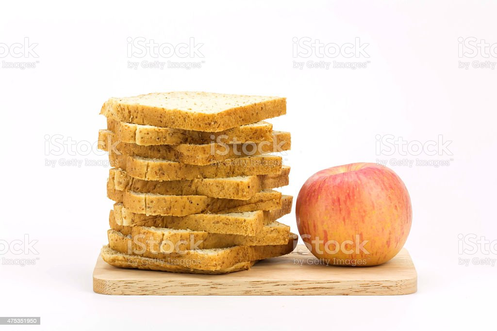 bread and apple isolated on white background royalty-free stock photo