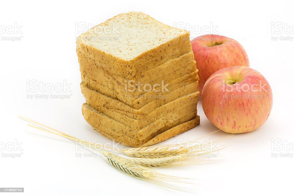 bread and apple isolated on white background,focus on bread royalty-free stock photo