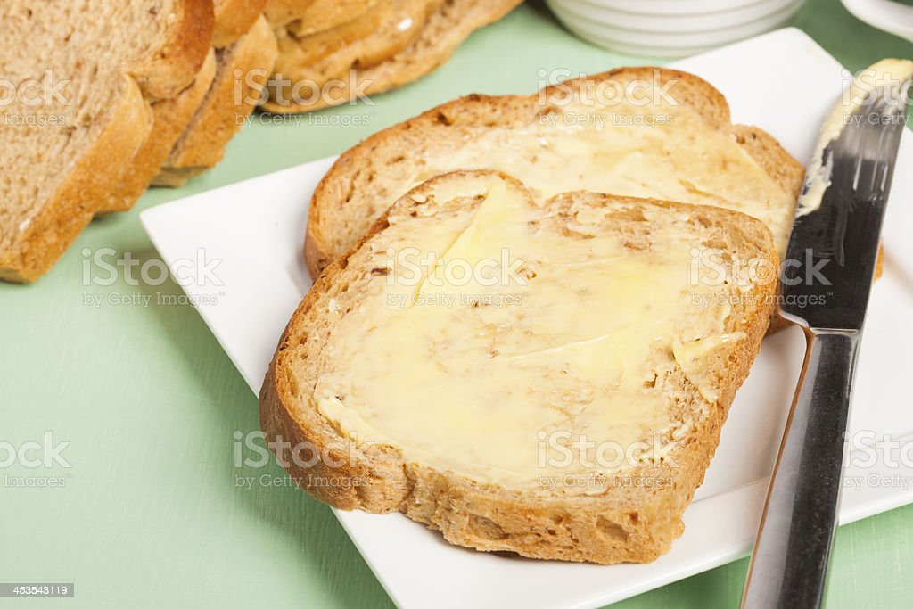 Bread and butter on square white plate royalty-free stock photo