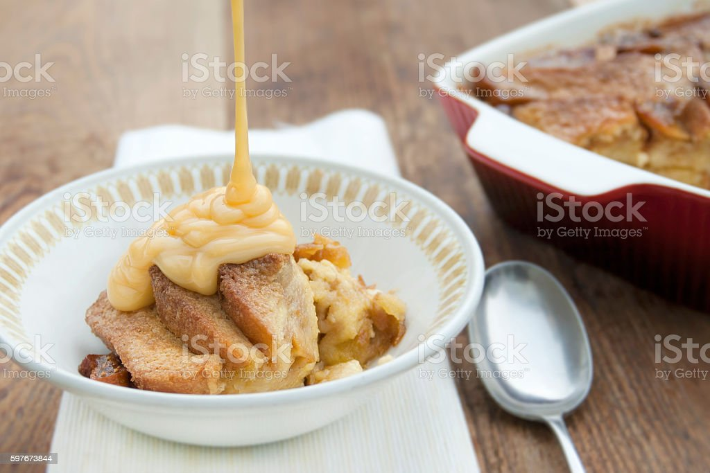Bread and Butter Pudding being served with Custard stock photo