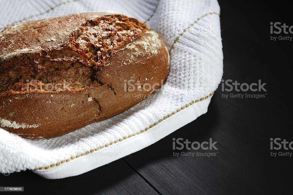 Bread and fabric on black table royalty-free stock photo