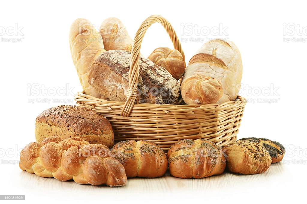 Bread and rolls in wicker basket isolated on white royalty-free stock photo