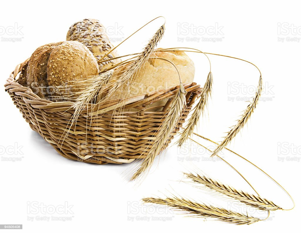 Bread and wheat in a basket royalty-free stock photo