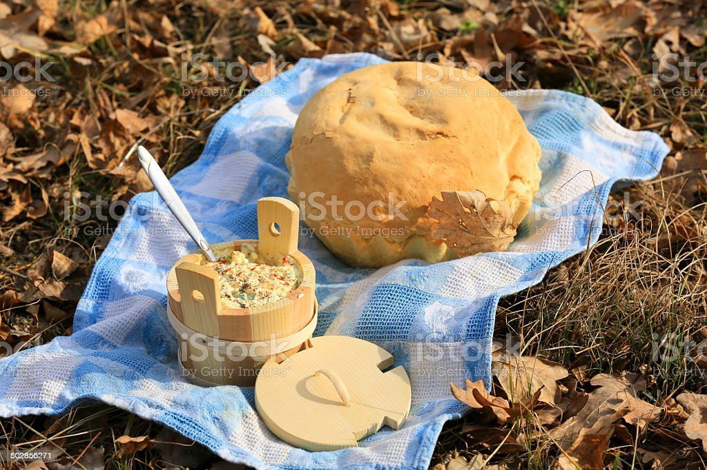 bread and wooden dish on blue cloth royalty-free stock photo