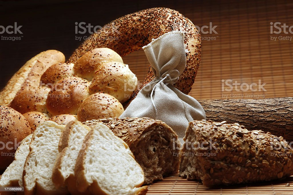 Bread Assortment of baked goods in wood background royalty-free stock photo