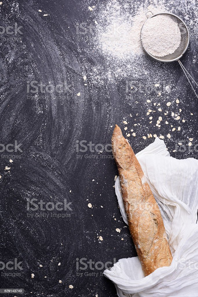 Bread baguette fresh baked, sieve with flour. stock photo